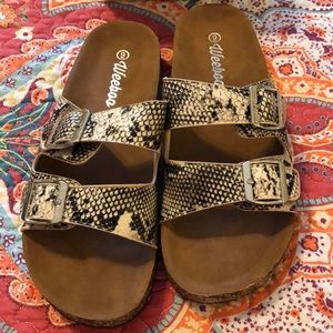 Sandals...size 9. Running 1/2 size small.
